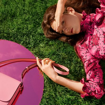 Kate Spade Princes Square - image of girl lying on grass with kate spade bag