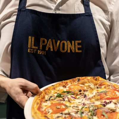 Man holding Pizza Il Pavone
